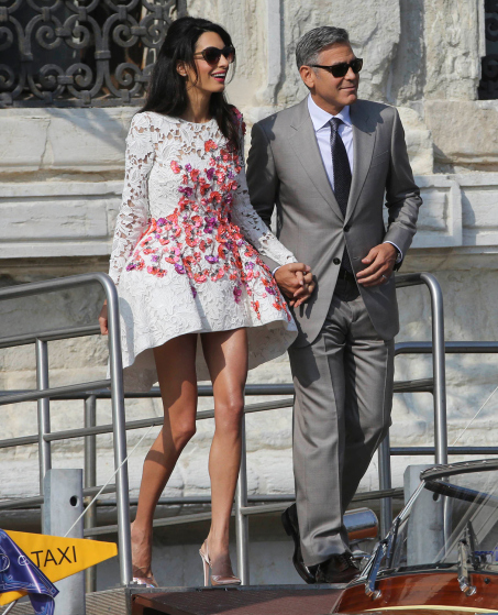 U.S. actor Clooney and his wife Alamuddin leave the seven-star hotel Aman Canal Grande Venice in Venice