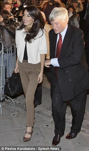 1413232126339_Image_galleryImage_Amal_Alamuddin_arrives_at