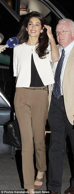 1413232199085_wps_16_Amal_Alamuddin_arrives_at
