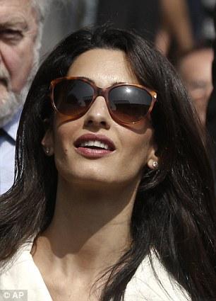 1413373886553_Image_galleryImage_Lawyer_Amal_Clooney_arriv