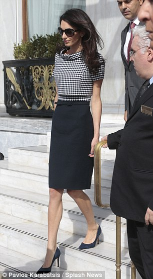 1413464055967_Image_galleryImage_Amal_Clooney_leaves_Athen