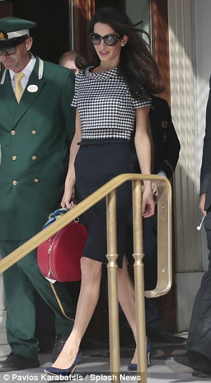 1413464126253_wps_78_Amal_Clooney_leaves_Athen