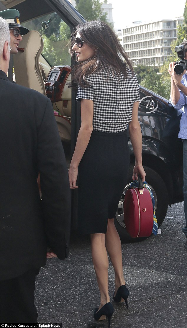 1413464130541_wps_79_Amal_Clooney_leaves_Athen