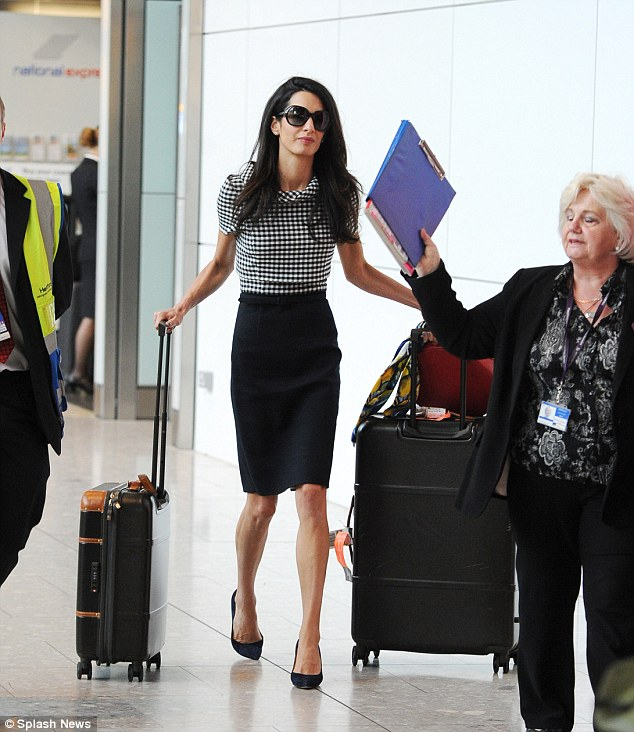 1413479147952_wps_7_Amal_Clooney_arrives_at_H