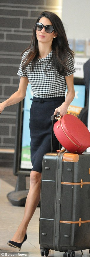 1413479828781_Image_galleryImage_Amal_Clooney_arrives_at_H