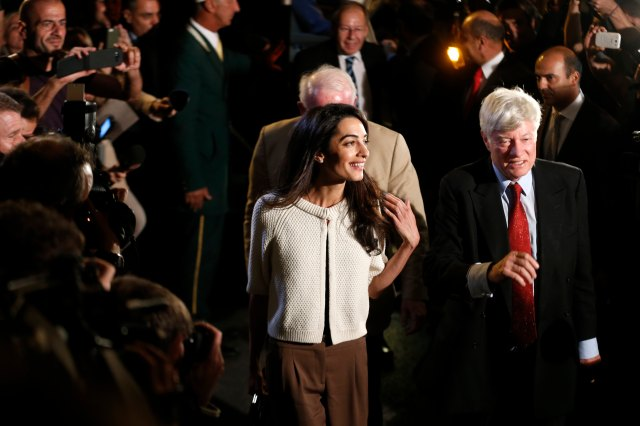 Human rights lawyer Amal Alamuddin Clooney and Geoffrey Robertson, head of Doughty Street Chambers, arrive at a hotel in Athens