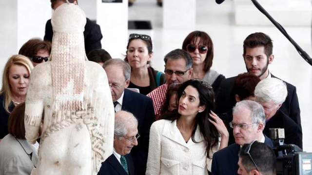 Human rights lawyer Amal Alamuddin Clooney observes a Kore statue during a visit at the Acropolis museum in Athens
