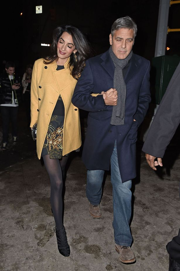 George-Clooney-and-wife-Amal-hold-hands-as-they-walk-back-to-their-hotel (1)