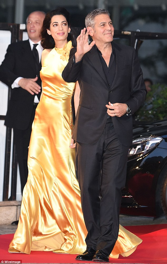 290EC47E00000578-3096100-The_power_couple_George_Clooney_and_his_wife_Amal_were_pictured_-m-70_1432554729771
