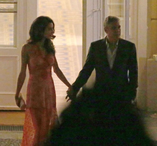**USA ONLY** London, UK -  Amal Clooney and George Clooney show us that they're still deep in the throes of love as they were spotted  having a romantic dinner at luxury hotel Ville D' Este in Italy.  Amal wore a sexy sheer red gown that showed off her toned legs, and Clooney looked more than happy to show off his beautiful bride as he amped up the PDA.  The two shared moonlight kisses while toasting to their love.     AKM-GSI       August 6, 2015 **USA ONLY**  To License These Photos, Please Contact : Steve Ginsburg (310) 505-8447 (323) 423-9397 steve@akmgsi.com sales@akmgsi.com or Maria Buda (917) 242-1505 mbuda@akmgsi.com ginsburgspalyinc@gmail.com