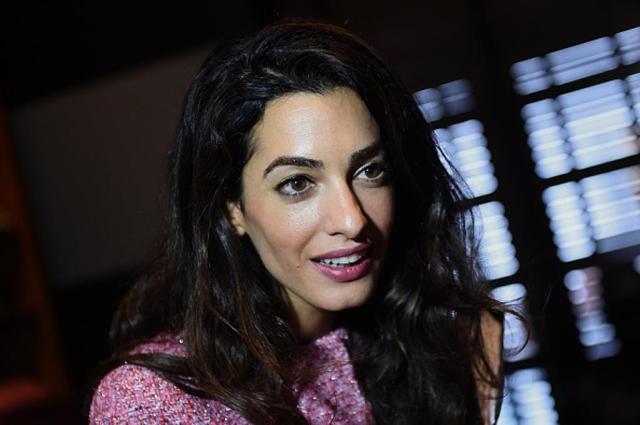 London-based human rights lawyer Amal Clooney meets members of the media at a hotel in the Sri Lankan capital Colombo on September 11, 2015. Clooney arrived from the Maldives where she spent four days pressing for the release of jailed former president Mohamed Nasheed.   AFP PHOTO / Ishara S. KODIKARA        (Photo credit should read Ishara S.KODIKARA/AFP/Getty Images)