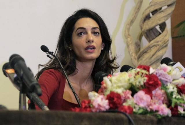 Human rights lawyer Amal Clooney speaks at a press conference at the Kurumba Maldives resort on the Maldives island of Vihamanafushi on September 10, 2015. Clooney attended a court hearing September 10 in the Maldives where state prosecutors have done a U-turn to appeal the conviction of former president Mohamed Nasheed. AFP PHOTO        (Photo credit should read STR/AFP/Getty Images)