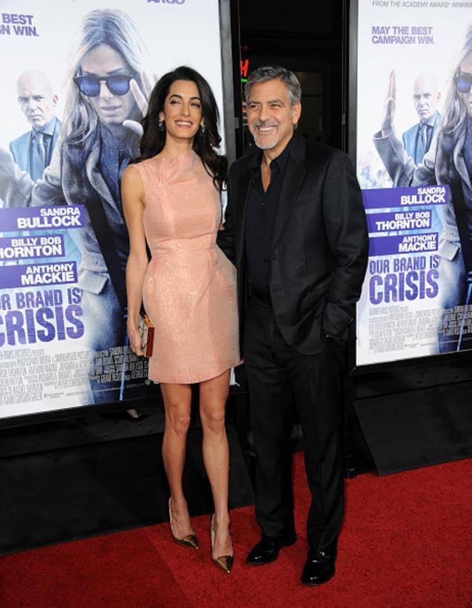 HOLLYWOOD, CA - OCTOBER 26: Attorney Amal Alamuddin and actor/producer George Clooney arrive for the premiere of Warner Bros. Pictures'