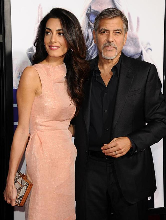 HOLLYWOOD, CA - OCTOBER 26: Amal Clooney and George Clooney attend the premiere of