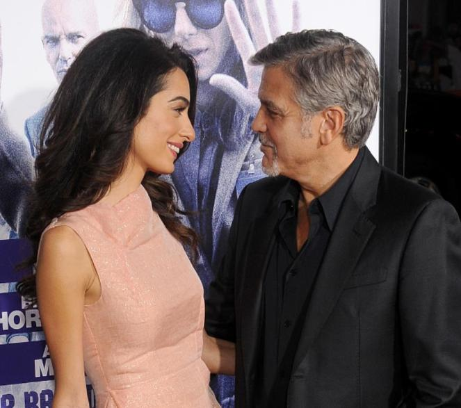 HOLLYWOOD, CA - OCTOBER 26: Actor George Clooney and wife Amal Clooney arrive at the premiere of Warner Bros. Pictures'