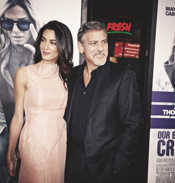 HOLLYWOOD, CA - OCTOBER 26: (Editors Note: This image has been processed using digital filters) Amal Alamuddin (L) and actor George Clooney attend the premiere of Warner Bros. Pictures' 'Our Brand Is Crisis' at TCL Chinese Theatre on October 26, 2015 in Hollywood, California. (Photo by Tibrina Hobson/Getty Images)
