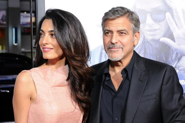 HOLLYWOOD, CA - OCTOBER 26: (L-R) Lawyer Amal Alamuddin Clooney and actor/producer George Clooney arrive at the Premiere of Warner Bros. Pictures' 'Our Brand Is Crisis' at TCL Chinese Theatre on October 26, 2015 in Hollywood, California. (Photo by Barry King/Getty Images)