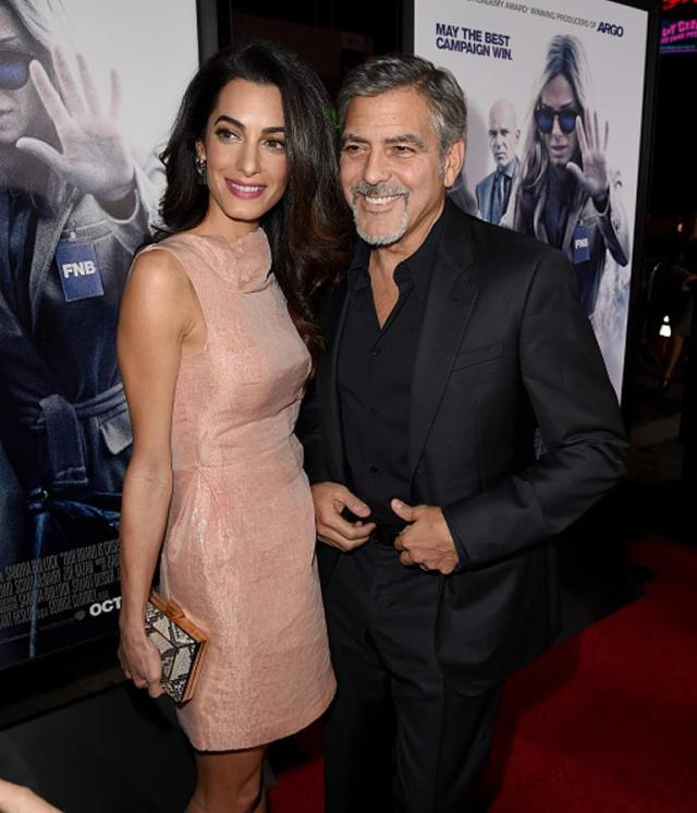 HOLLYWOOD, CA - OCTOBER 26: Amal Alamuddin (L) and actor George Clooney attend the premiere of Warner Bros. Pictures'