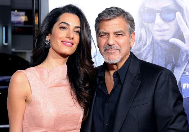 HOLLYWOOD, CA - OCTOBER 26: Lawyer Amal Alamuddin Clooney and actor/producer George Clooney arrive at the Premiere of Warner Bros. Pictures' 'Our Brand Is Crisis' at TCL Chinese Theatre on October 26, 2015 in Hollywood, California. (Photo by Barry King/Getty Images)