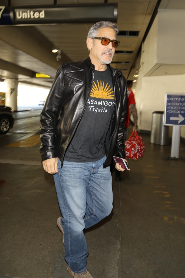 Please contact X17 before any use of these exclusive photos - x17@x17agency.com George Clooney and Amal Alamuddin catch a flight at LAX. George is wearing an Casamigos tee shirt promoting the brand of tequilla that he owns with Rande Gerber and he is carrying his European passport November 8, 2015 X17online.com