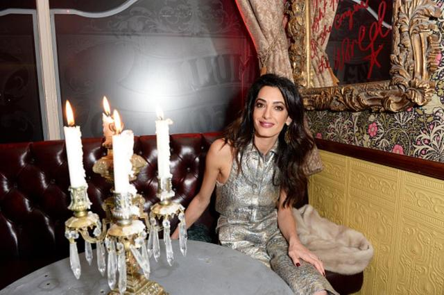 LONDON, ENGLAND - DECEMBER 03: Amal Clooney attends Charlotte Tilbury's naughty Christmas party celebrating the launch of Charlotte's new flagship beauty boutique in Covent Garden on December 3, 2015 in London, England. (Photo by David M. Benett/Dave Benett/Getty Images for Charlotte Tilbury)