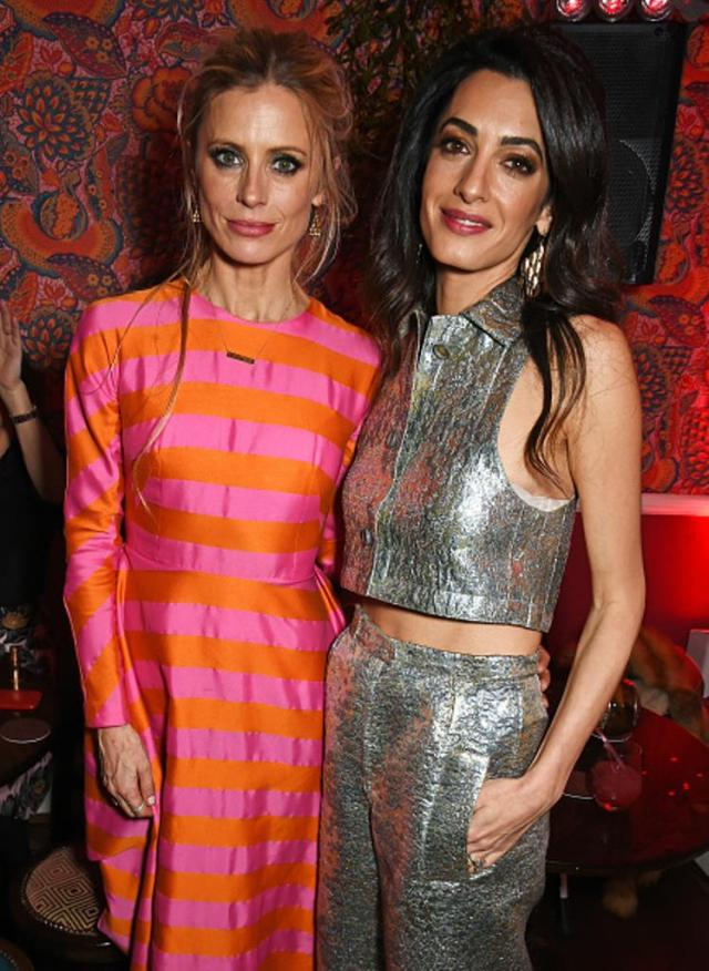 LONDON, ENGLAND - DECEMBER 03: Laura Bailey (L) and Amal Clooney attend Charlotte Tilbury's naughty Christmas party celebrating the launch of Charlotte's new flagship beauty boutique in Covent Garden on December 3, 2015 in London, England. (Photo by David M. Benett/Dave Benett/Getty Images for Charlotte Tilbury)