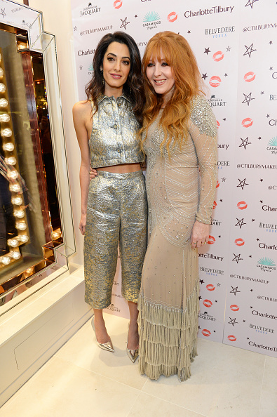 LONDON, ENGLAND - DECEMBER 03: Amal Clooney (L) and Charlotte Tilbury attend Charlotte Tilbury's naughty Christmas party celebrating the launch of Charlotte's new flagship beauty boutique in Covent Garden on December 3, 2015 in London, England. (Photo by David M. Benett/Dave Benett/Getty Images for Charlotte Tilbury)