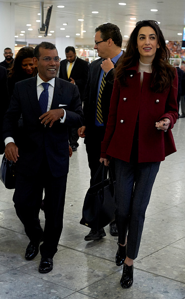 Former Maldives president Mohamed Nasheed (L) and his British lawyer Amal Clooney walk after Nasheed arrived at Heathrow airport in London on Janurary 21, 2016. Nasheed left the Maldives on Monday after the Indian Ocean islands' government granted him prison leave for urgent surgery. Nasheed, became the first democratically elected president of the Maldives in 2008 and served for four years before he was toppled in what he called a coup backed by the military and police. He was sentenced to 13 years in jail on terrorism charges relating to the arrest of an allegedly corrupt judge in 2012, when he was still in power. AFP PHOTO / NIKLAS HALLE'N / AFP / NIKLAS HALLE'N (Photo credit should read NIKLAS HALLE'N/AFP/Getty Images)