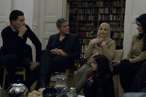 IRC President and CEO David Miliband, George Clooney, and Amal Clooney meet with Syrian Refugees Mona (woman) and her daughter, 11-year-old Joudi (young girl)