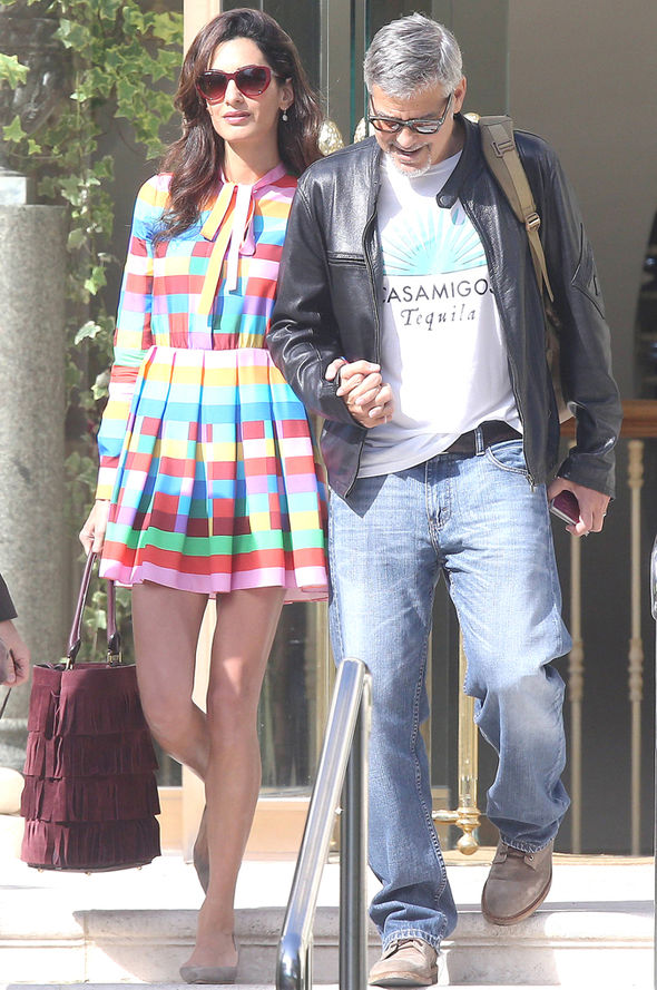 Amal-and-her-husband-George-held-hands-as-they-left-their-hotel-538860