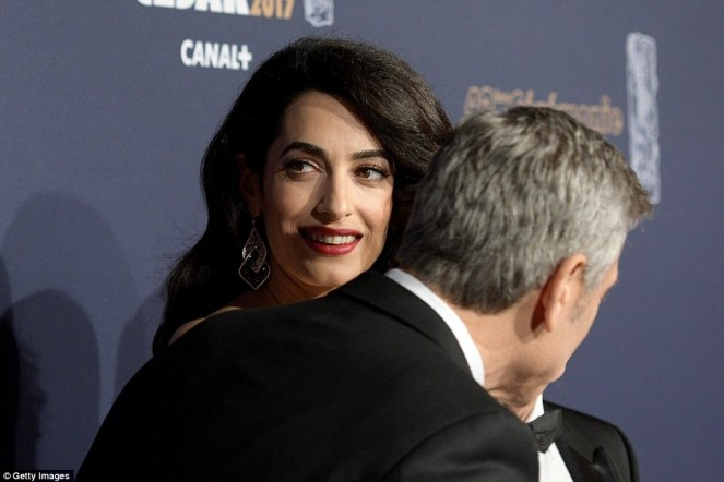 3da08add00000578-4257816-do_you_want_to_know_a_secret_george_leaned_into_amal_as_they_pos-a-48_1487972810563