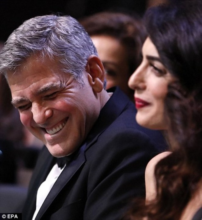 3da0ee9f00000578-4257816-having_a_ball_george_and_amal_appeared_to_share_a_giggle_as_they-a-1_1487972930799