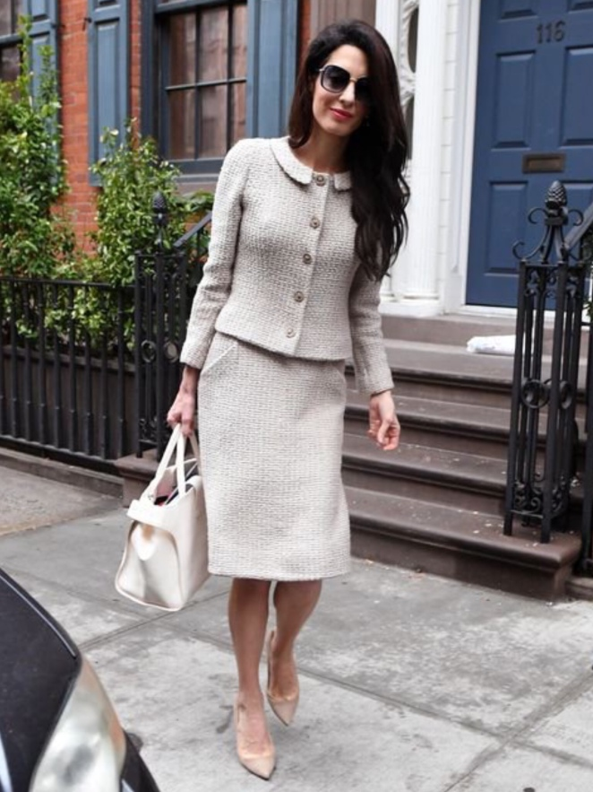 f0cc1d90bc1a5 Amal Clooney once again proved her enviable work wardrobe as she stepped  out in New York City on Thursday – wearing a classic bouclé skirt suit and  matching ...