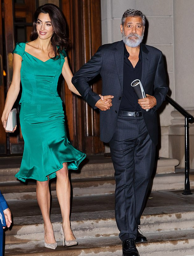19187714-7527417-Close_of_evening_George_and_Amal_could_also_be_spotted_holding_h-a-44_1570005553533